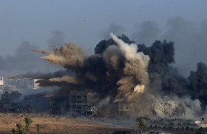 An explosion during an Israeli strike in the northern Gaza Strip early in the morning of July 26, 2014