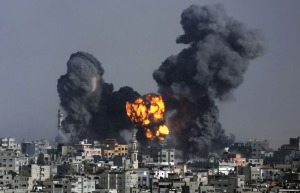 Smoke and fire from the explosion of an Israeli strike rise over Gaza City on July 22, 2014